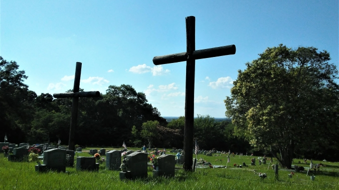 wooden cross erected in a cemetery