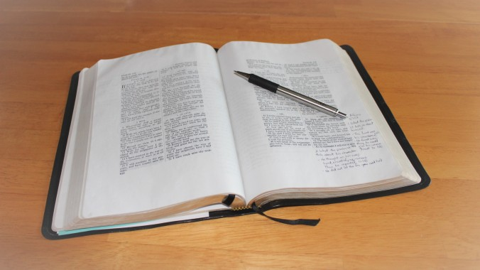 Bible on table, open to Psalm 119