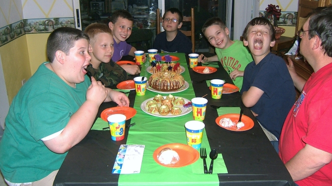 boys' birthday party, at the table having cake
