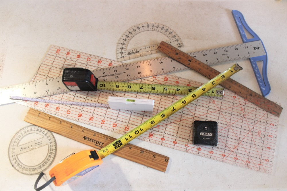 a variety of measuring tools on a table